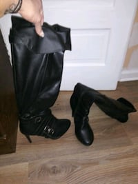 pair of black leather boots Akron
