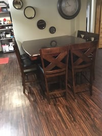 Rectangular brown wooden table with six chairs dining set East Hartford, 06118