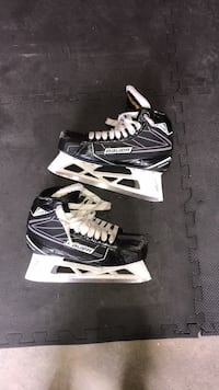 pair of black-and-white ice skates Whitby, L1R
