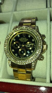 round gold-colored Rolex chronograph watch with link bracelet Brampton, L6T