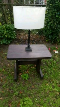 Wooden table and lamp