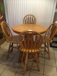 "High Kitchen Table $130.00 May trade for 30"" high table with 4 chairs."