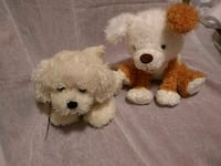 two white and brown dog plush toys