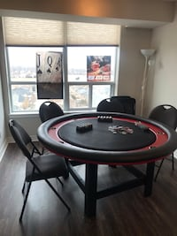 Hand made round poker table for 8 with thousands chips