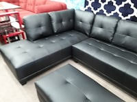 Brand new black faux leather sectional with cup holder and ottoman College Park