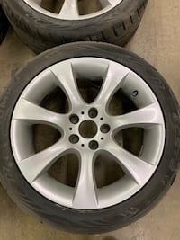 4 SILVER BMW 7 SPOKE 18 INCH WHEELS. PN#  [PHONE NUMBER HIDDEN] 618 WITH TIRES