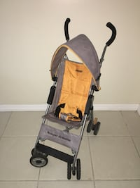 baby's brown and black stroller Palm Coast, 32137