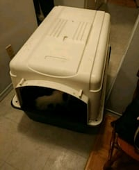 white and blue plastic pet carrier
