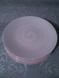 round white and pink ceramic plate