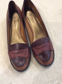 Pair of brown I.N.C. leather penny loafers. Size 7 1/2 Pincourt, J7W