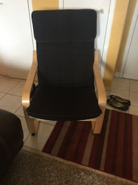Black wooden framed black padded armchair Toronto, M6M 3A3
