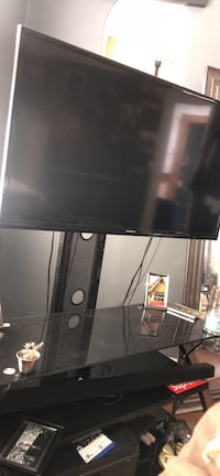 Samsung 40 in TV with a 3 tier entertainment stand  Atlanta, 30307