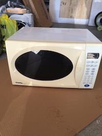 white and black microwave oven