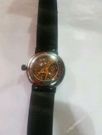 round silver-colored chronograph watch with black leather strap Singapore