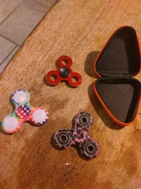 Three fidget spinners with case Houston, 77091