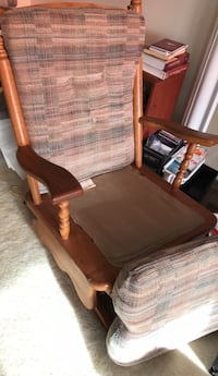brown wooden framed brown padded armchair 22 km