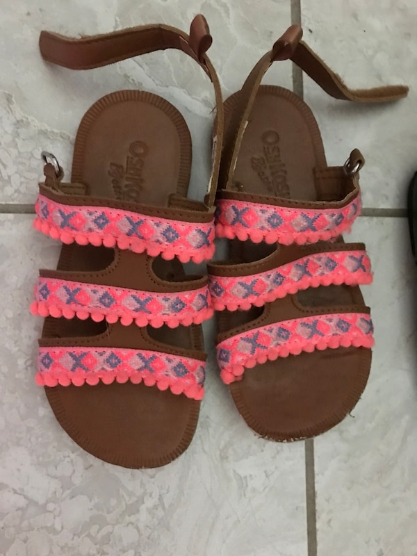 pair of red-and-brown sandals