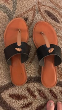 pair of black-and-brown leather sandals Carolina Beach, 28428