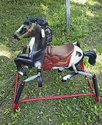 white, red, and black horse hopper
