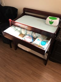 Brown wooden changing table with changing pad Maple Ridge, V2W 1R8