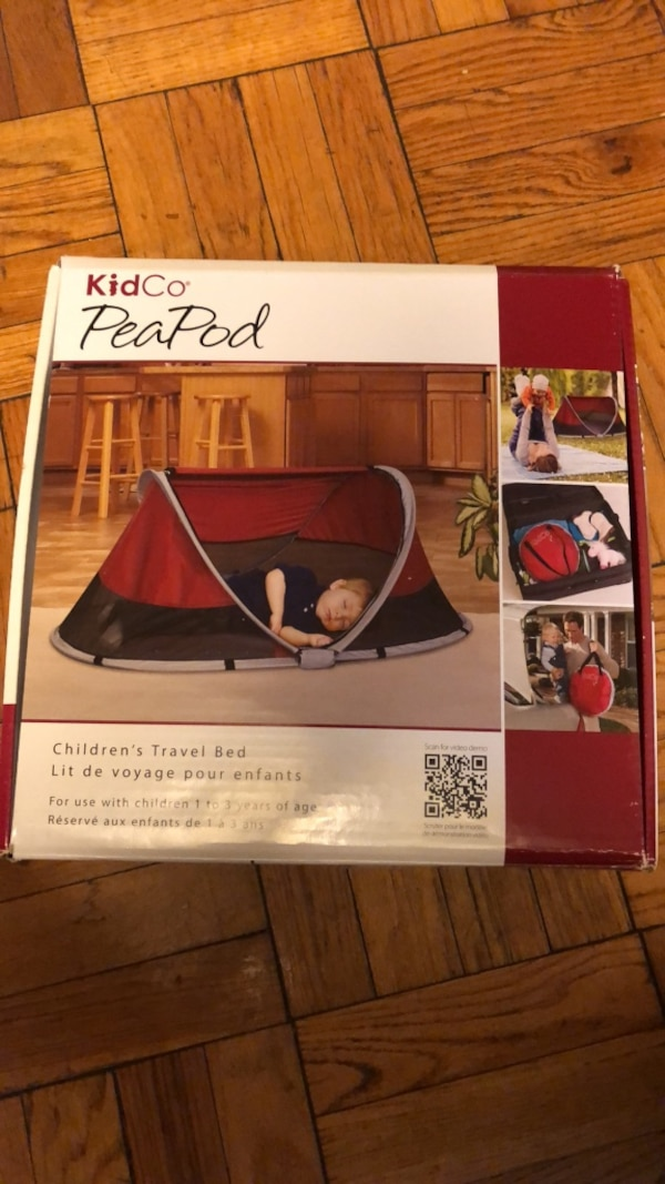 red and black Coleman camping tent box