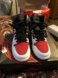 Pair of white-and-red air jordan shoes New Orleans, 70128