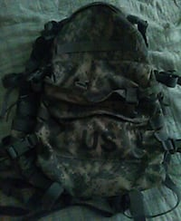 brown, green, and black digital camouflage backpac Arlington, 76018