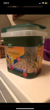 bird toys/lightly used container of parakeet food