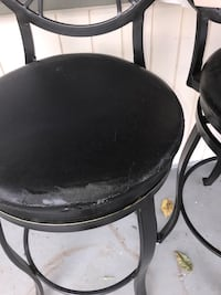 Four black metal framed black leather padded chairs 1174 mi