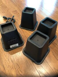 Bed risers for dorm room with outlets.  Ladue, 63124