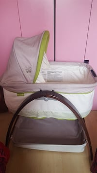 baby's white and green bassinet Saint-Eustache, J7R 5G3