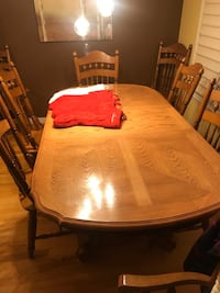Oval brown wooden table with six chairs dining set Edmonton, T5X 4P9