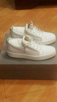 pair of white low-top sneakers with box