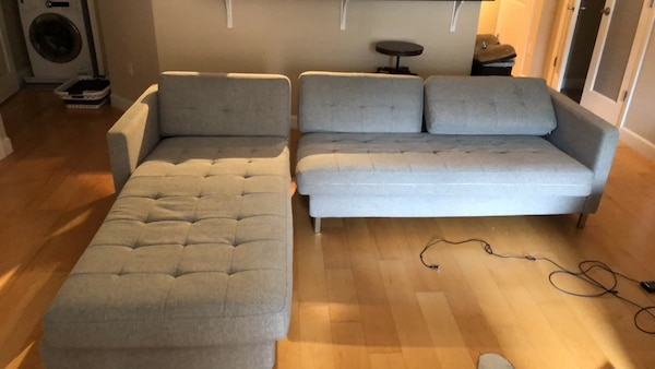 two tufted gray suede sofa chairs