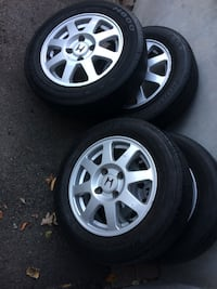 four gray Honda 8-spoke vehicle wheels with tire