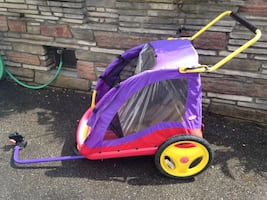 Purple and yellow bicycle trailer