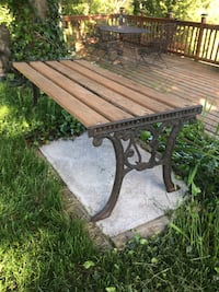 Garden cast iron and reclaimed red cedar bench