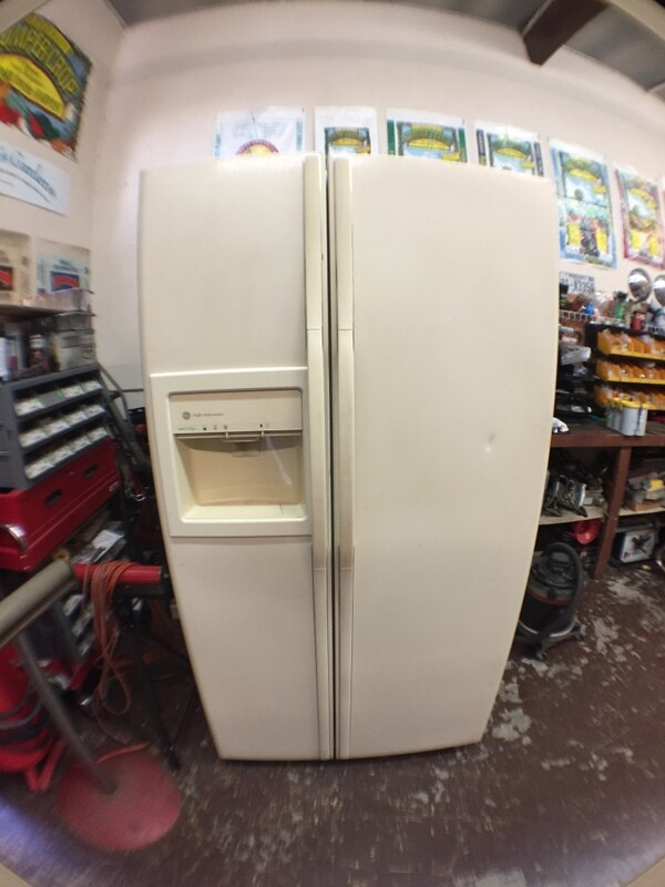 White General Electric side-by-side refrigerator