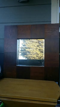 square brown wood-framed wall mirror