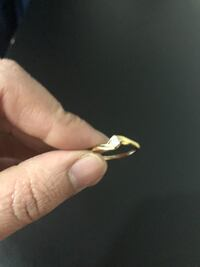 gold-colored diamond ring