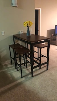 Bar table and 4 chairs *pick up only*