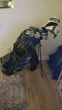 blue and black golf bag with golf clubs Chambly, J3L