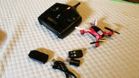 black and red quadcopter with remote 47 mi