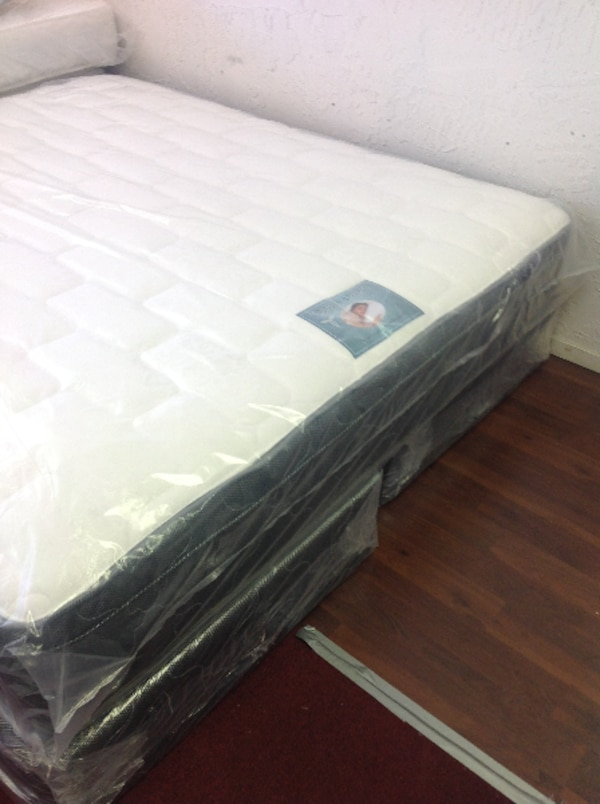 black wooden bed frame with white mattress eae52045-55ff-421e-a39c-fe948ec81772