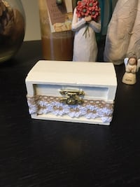 White ring box with lace ribbon