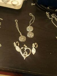 silver-colored necklace and earrings 521 km