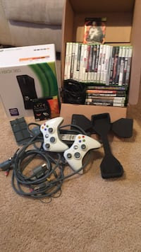 Xbox 360 console with controller and game cases East Islip, 11730