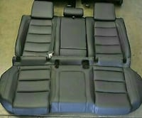 Black leather vehicle bench seat