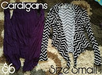 two small black and purple cardigans