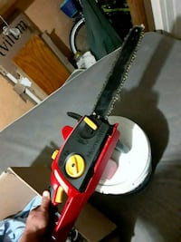 "red and black 14"" electric chain saw Baltimore, 21230"